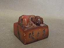 A Chinese soapstone seal decorated with carved wat