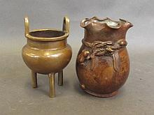 A small Chinese twin handled bronze censer on trip