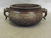 An early Chinese bronze censer with relief decorat