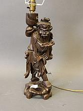 An Oriental carved wood lamp, 15'' high