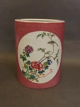 A Chinese pink ground porcelain brushpot with deco