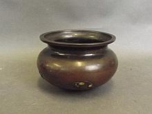 An Oriental bronze censer with relief decoration o