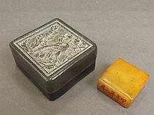 A Chinese yellow soapstone seal in a green soapsto