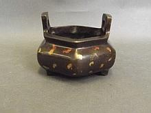 A Chinese twin handled hexagonal bronze censer on