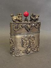 A Chinese white metal oval pot and lid with twin F