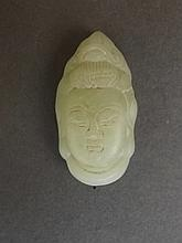 A small Chinese light green jade pendant carved in