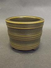 A Chinese tea dust glazed ribbed porcelain censer