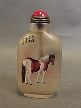 A Peking glass snuff bottle with reverse painted d