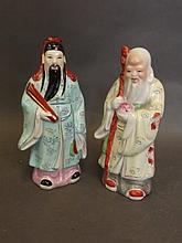 A pair of Chinese enamelled porcelain figures of S