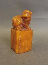 A Chinese soapstone seal with carved kylin knop an