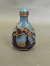 A Peking blue glass snuff bottle with carved bat d