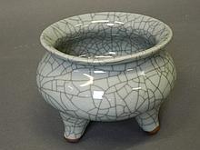 A Chinese crackle glazed pottery censer on tripod