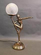 An Art Deco style composition lamp in the form of