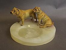 Two cold painted bronze boxer dogs mounted on a ci
