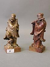 A pair of Chinese soapstone carvings of figures, o