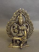 An Oriental silvered metal model of Buddha with fo