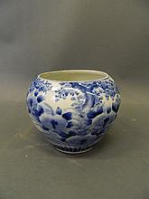 A Japanese blue and white porcelain pot with paint