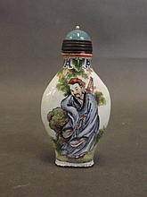 A Cantonese enamelled brass snuff bottle with pain