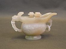 A Chinese white jade libation cup/pourer with carv