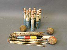 A part croquet set and seven outdoor bowling pins