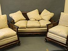 An early C20th walnut bergere suite of two chairs