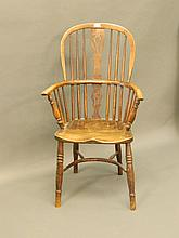A C19th drop back elbow chair with pierced splat a