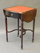 An Edwardian drop leaf single drawer side table wi