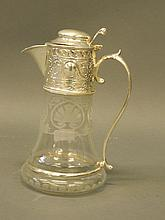 An etched glass claret jug with silver plated coll