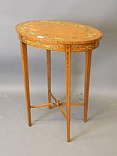 An Edwardian oval shaped satinwood occasional tabl