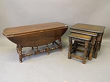 A nest of three Ercol dark oak occasional tables,