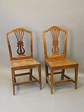 A set of twelve Ottoman solid elm dinning chairs w