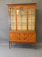 An Edwardian satinwood display cabinet with painte