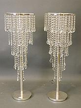 A pair of five tier crystal lustres on chrome stan