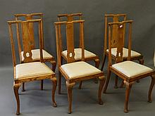 A set of six oak Arts & Crafts dining chairs with