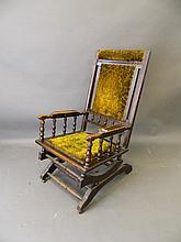A late C19th American walnut rocking chair