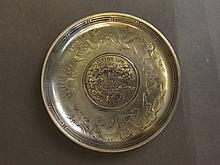 A Chinese white metal coin dish with central set c
