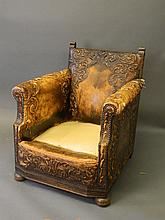 An Ottoman studded leather club chair with embosse
