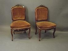 A pair of late C19th/early C20th French walnut sid