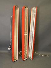 Three industrial painted metal strip lights, two f