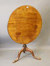 A George III mahogany tilt top occasional table on