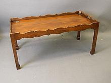 A mahogany coffee table with shaped gallery and fr