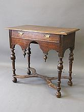 An C18th oak lowboy with single drawer and shaped
