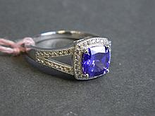 A silver and cubic zirconia ring with central set