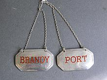 A pair of silver and enamel set bottle labels 'Por
