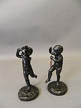 A pair of cold painted bronze figures of cherubs p
