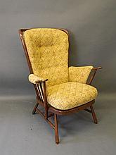 An Ercol stained beech armchair, 40'' high
