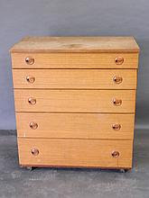 A 1960s Schreiber teak chest of five long drawers
