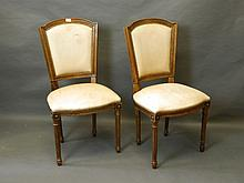 A pair of Continental side chairs with shaped back