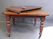 A Victorian mahogany wind-out dining table on turn