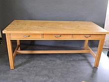 A contemporary beechwood kitchen table with solid